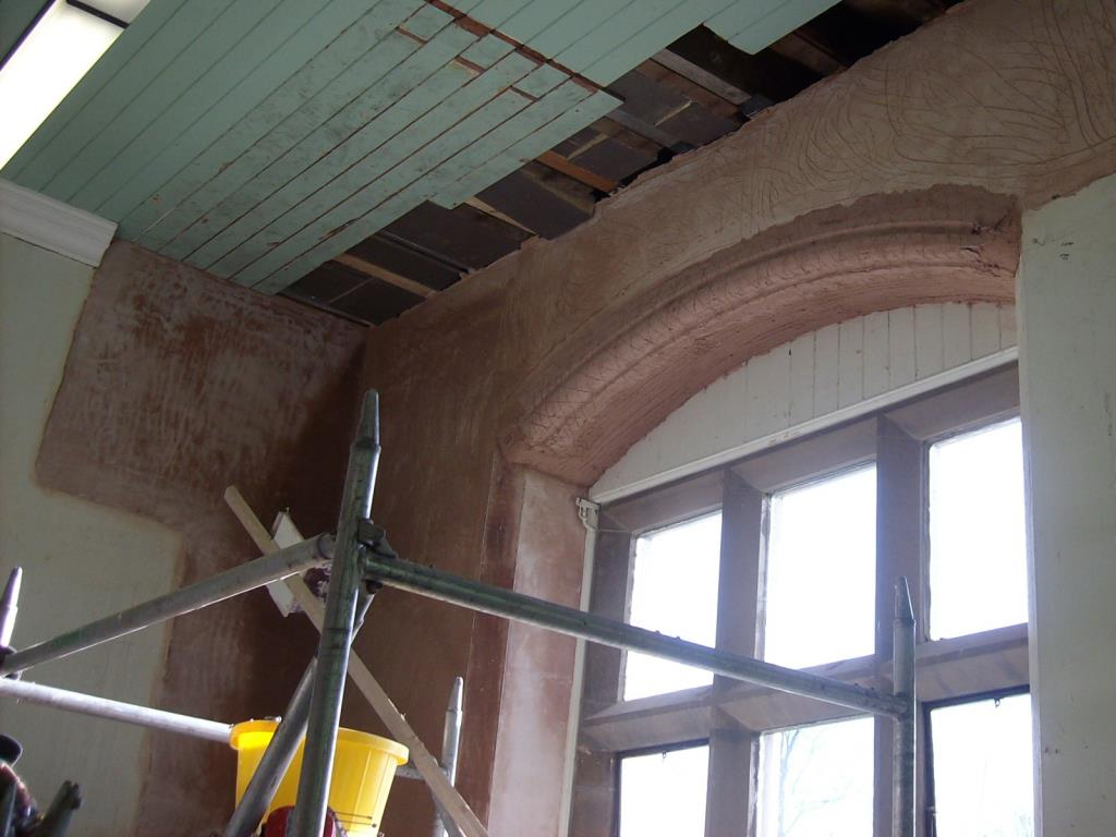 In Situ Plasterwork Arch Repair (1 of 4) - Scratch backing coat of lime plaster applied to an arch at Stonyhurst College, Lancashire