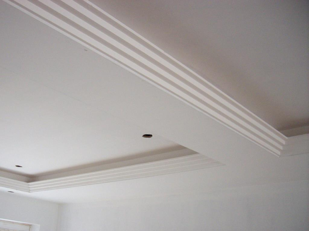 Small stepped plaster cornice used as an uplighter with a trough for strip lighting for house in the Lancaster area