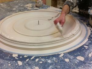 Photo - Running a plaster centrepiece in the workshop to a customer's own design